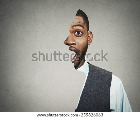 surrealistic portrait headshot front with cut out profile of a young astonished handsome man isolated grey wall background