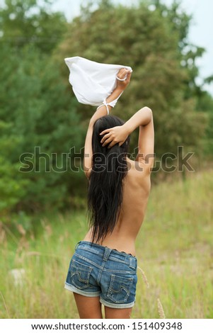 Surrendering girl with white flag - stock photo