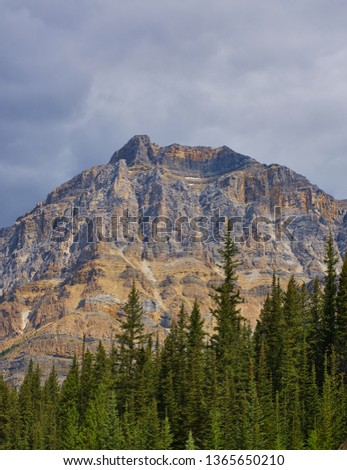 Surrounded by mountains and lakes in Rocky mountain ( Canadian Rockies ). Near Calgary. Portrait, fine art. Jasper, Yoho and Banff National Park. Alberta, British Columbia, Canada: August 4, 2018 #1365650210