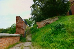 Surroundings of Malbork castle. An old staircase and part of a ruined brick wall.