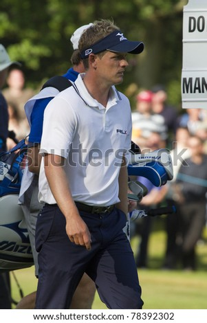 SURRY, ENGLAND - MAY 29: Luke Donald  walks to hole 18 during day four of  BMW PGA Championship on May 29, 2011 at the Wentworth Club in Surrey, England.  Donald wins First  place .
