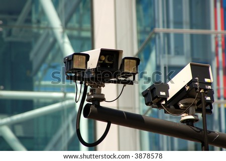 Surveillance Camera mounted on a post. - stock photo