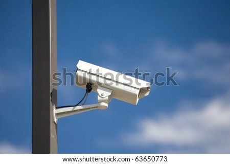 surveillance camera on light pole in parking lot