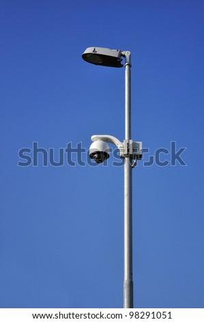 Surveillance camera on street lamp
