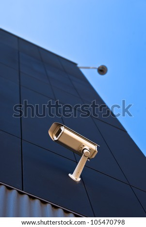 surveillance camera on the wall of a public building