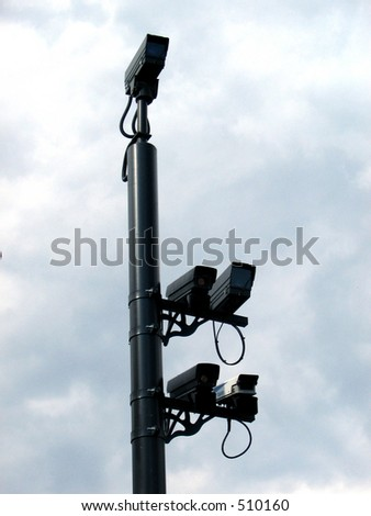 Surveillance Cameras mounted on a metal post.