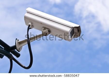 Surveillance Security Camera or CCTV on blue sky