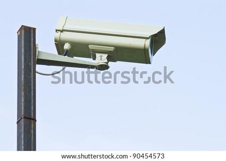 Surveillance Security Camera or CCTV on blue sky - stock photo