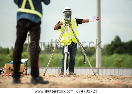 survey engineer in construction site use theodolite mark a concrete pile co ordinate in construction site