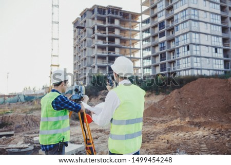 Survey engineer on the construction site and on the construction site. geodesy