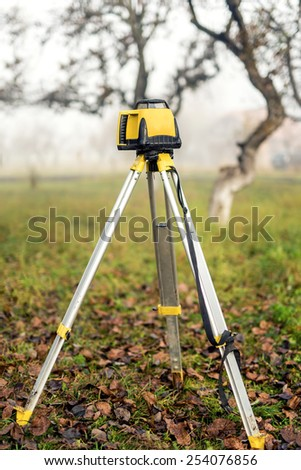 Surveying measuring equipment level theodolite on tripod
