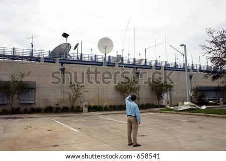 Surveying the damage at National Oceanic and Atmospheric Administration, NOAA; National Weather Service at Florida International University, FIU.