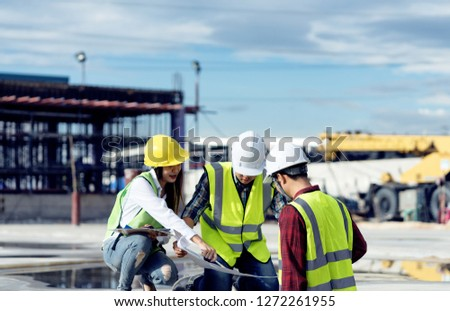 surveyor engineer with theodolite at construction site during surveying work.engineer and architect working at construction site with blueprint #1272261955