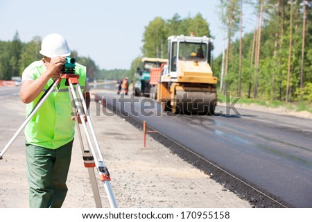 surveyor engineer worker making ...