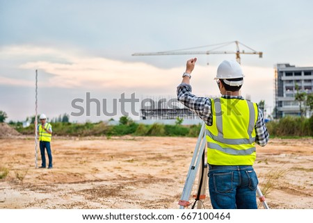 Surveyor Engineering. Surveyor's telescope at construction site. Surveying for making contour plans are a graphical representation of the lay of the land before startup construction work #667100464