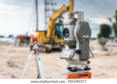 Surveyor equipment for line checking or theodolite outdoors at construction site #305640317