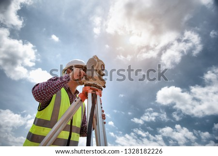 Surveyor equipment. Surveyor's telescope at construction site or Surveying for making contour plans are a graphical representation of the lay of the land before startup construction work  #1328182226