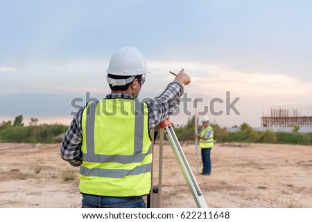 Surveyor equipment. Surveyor's telescope at construction site or Surveying for making contour plans are a graphical representation of the lay of the land before startup construction work  #622211648
