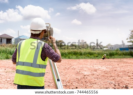 Surveyor equipment. Surveyor's telescope at construction site or Surveying for making contour plans are a graphical representation of the lay of the land before startup construction work #744465556