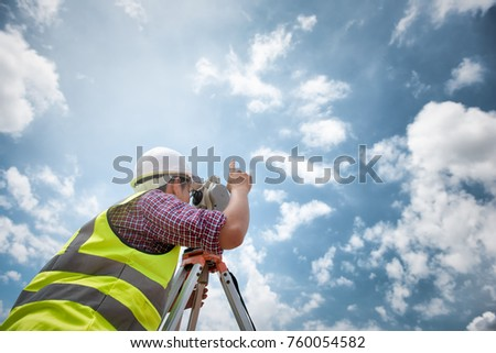 Surveyor equipment. Surveyor's telescope at construction site or Surveying for making contour plans are a graphical representation of the lay of the land before startup construction work  #760054582