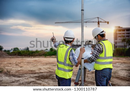 Surveyor equipment. Surveyor's telescope at construction site, Surveying for making contour plans are a graphical representation of the lay of the land before startup construction work  #1300110787