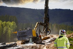 surveyor measuring rock-drilling for dynamiting, civil-engineering