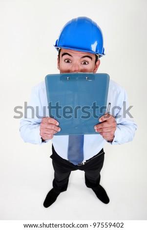 Surveyor peering over his clipboard