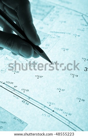 surveyor's plan and pencil with monochrome backlight