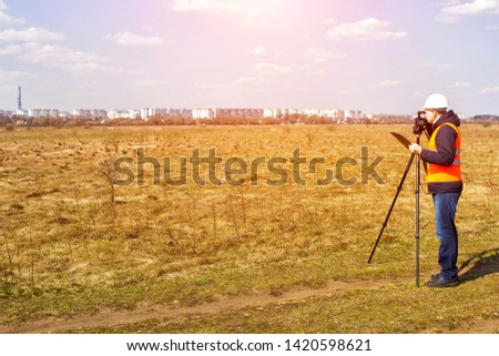 Surveyor worker measures the distance and length using measuring equipment for the construction of a new micro district, copy space, Angle measurement