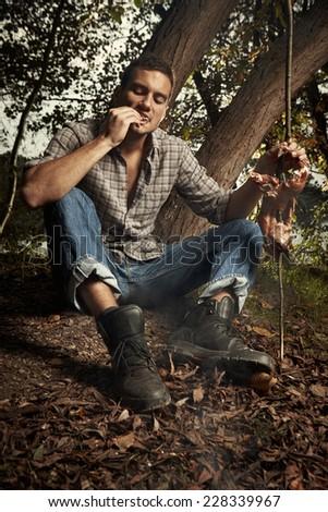 Survival man in wild nature