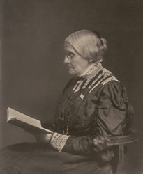 Susan B. Anthony sitting and reading a book, ca. 1900. Born in 1820, she celebrated her eightieth birthday at the White House at the invitation of President William McKinley.