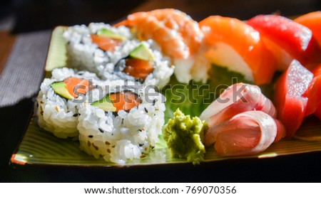 Sushi and sashimi set with wasabi and ginger on a plate