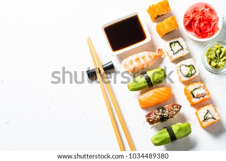 Sushi and sushi roll set on white background. Traditional asian food. Top view copy space.