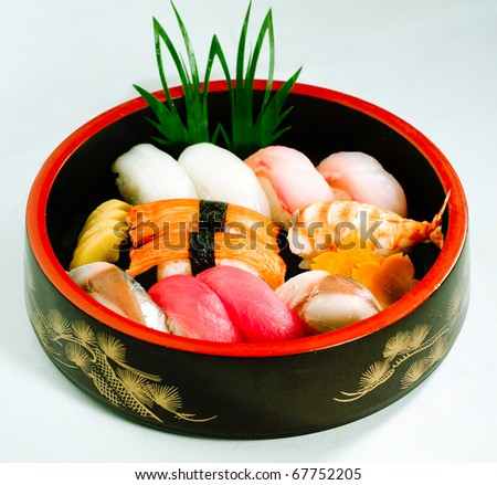 Sushi Bento a great taste of japanese food in a round box isolated - stock photo