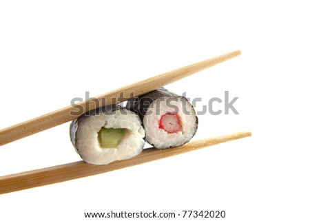 Sushi between two sticks isolated over white
