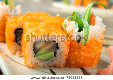 sushi from avocado, a salmon and red caviar