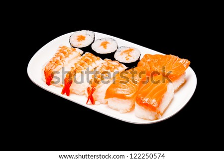 sushi in white plate on black background