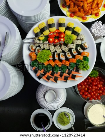 sushi is a famous food from japan.it's variety of type.this picture is sushi decorate,it's beautiful.