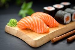 Sushi Nigiri with fresh salmon and Maki roll with salmon