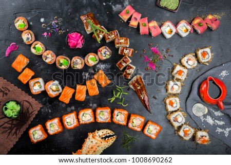 Sushi on a black background. Sushi rolls, nigiri, pickled ginger, wasabi, soy sauce. Sushi set on a table. Top view. Asian or Japanese food. Sushi restaurant concept