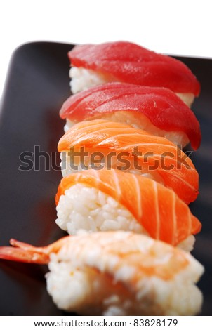 sushi on a brown dish