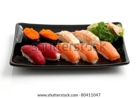 Sushi on black dish isolated in white background