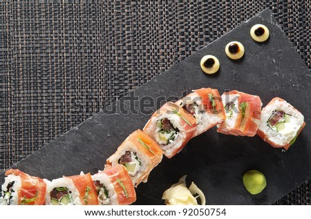 sushi on the black stone plate