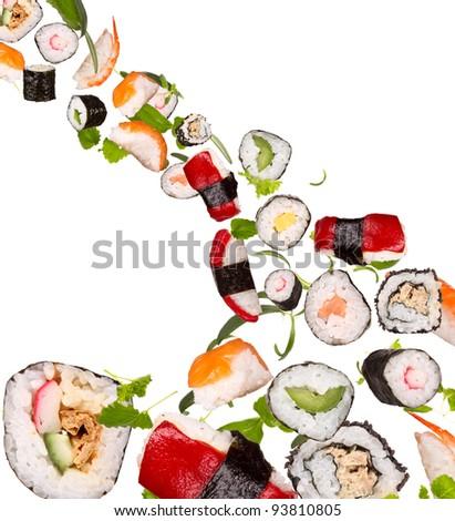 Sushi pieces flying on white background
