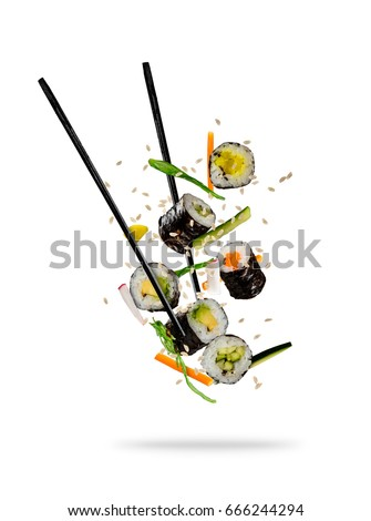 Shutterstock Sushi pieces placed between chopsticks, separated on white background. Popular sushi food.