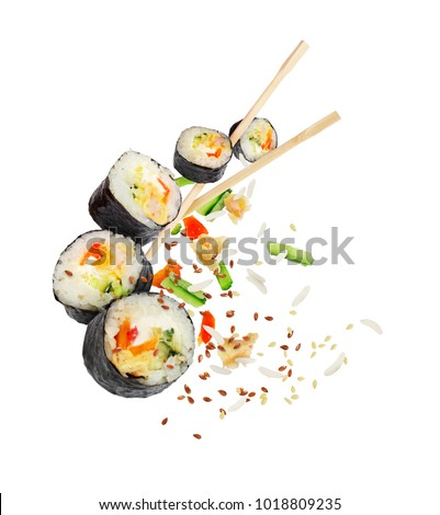 Sushi pieces with chopsticks frozen in the air isolated on white background