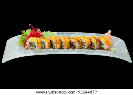 sushi plate isolated on black, studio shot - stock photo