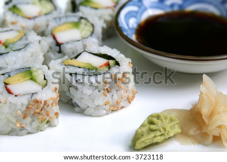 Sushi roll of avocado, crab-meat and cucumber, served with soy sauce ...