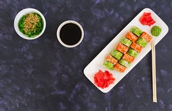 Sushi roll on dark background. Top view
