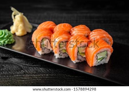 Sushi roll (Philadelphia) with salmon, smoked eel, avocado, cream cheese on black background. Sushi menu. Japanese food. Photo stock ©